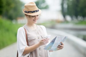 A women discovering Smart Destinations in the map to visit them and has a great tourist experience