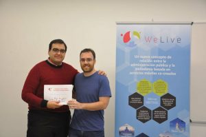 Antonio Jara, HOP Ubiquitous CEO, picking up the award from WeLive team.